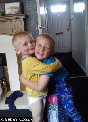Ruben hugging brother Craig, four, who raised the alarm on the night of the allergic reaction