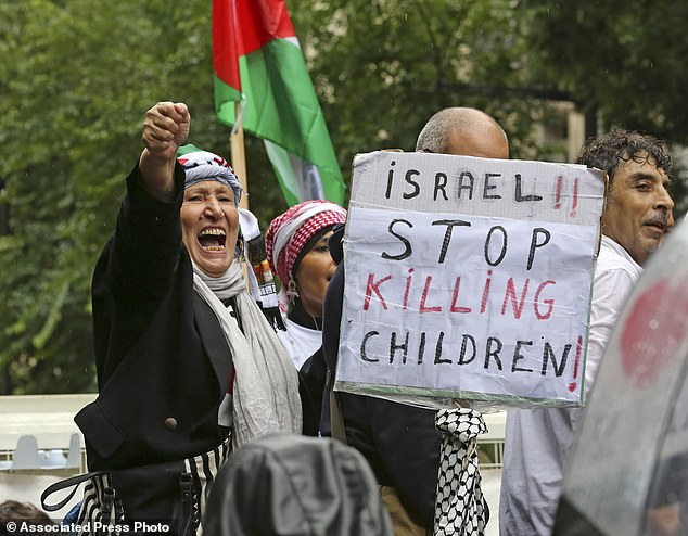 A pro-Palestinian demonstrator shouts anti Israeli slogans in Paris on Sunday. The French government is attempting to prevent planned marches this weekend from going ahead