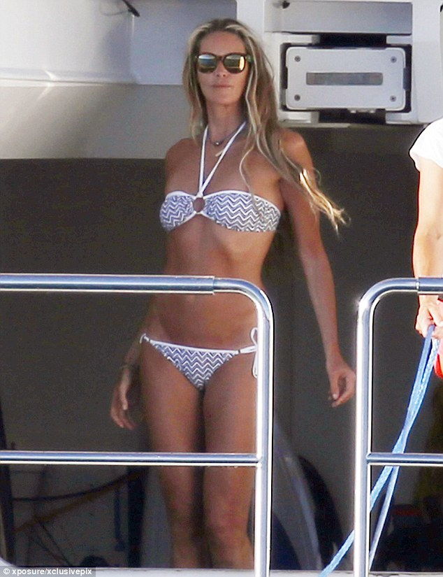 Tanned beauty: The 50-year-old beauty stripped down to a blue and white zig-zag two-piece for her break on the boat
