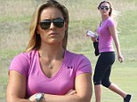 Lindsey Vonn looks glum as she watches boyfriend Tiger Woods struggle during the British Open