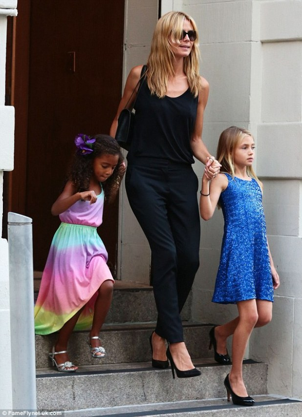 Just like mommy! Heidi Klum held onto her daughter Lou Samuel (L) and Leni Samuel (R), who both took after their model mother and wore their own heels in New York City on Friday