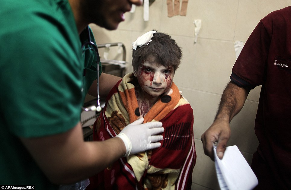 A Palestinian boy, who medics said was wounded by Israeli shelling, receives treatment at al-Shifa hospital in Gaza City