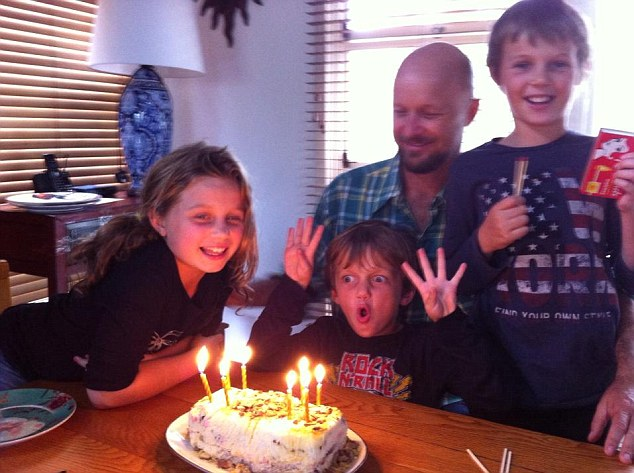 Evie, Otis, and Mo Maslin (pictured left to right with their father, Anthony) were victims of the MH17 crash. Their father will take indefinite leave from his role as head of mining company Buxton Resources to deal with the tragedy