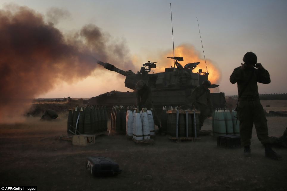 Frontline: Israeli soldiers of the 155mm artillery cannons unit fire towards the Gaza Strip from their position near Israel's border with the coastal Palestinian enclave today