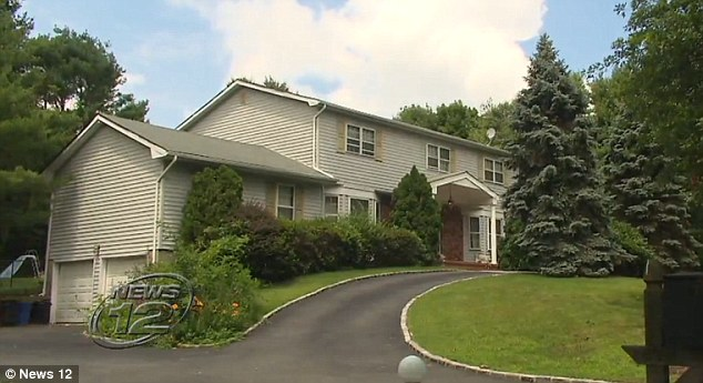 The attack happened at the family Dix Hills home on Long Island, New York. The father came home and found his younger son dead and his wife gravely injured