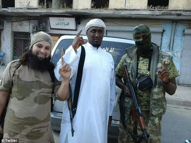 Militant: Numerous images of Taymullah al-Somali (centre) have emerged, including this one showing him posing alongside two men from Belgium. The man on the left reportedly named Hicham Chaib
