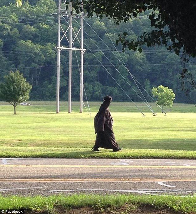 Spotted: A person photographed the mystery woman walking near a park in Athens, Ohio about 6.50pm Friday (pictured) and posted it online