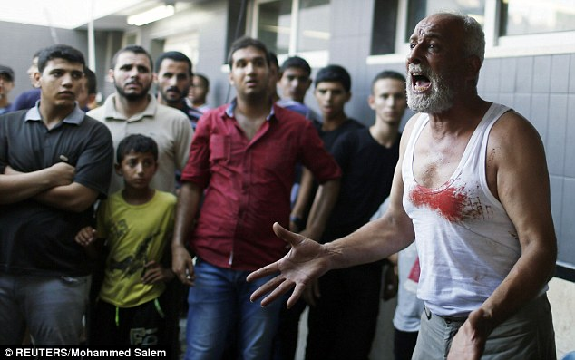 A father reacts after learning of the death of his son in the attack, which locals said was an an Israeli air strike