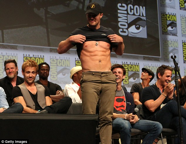 Well, you asked for it: Stephen Amell obliging complied with a fan's request to shows off his six-pack during a Q&A panel for Warner Bros. and DC Entertainment at Comic-Con in San Diego on Saturday