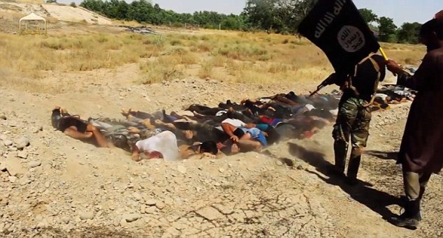 Brutal: Lying face down in the dirt, the prisoners are systemically executed by a small band of jihadists