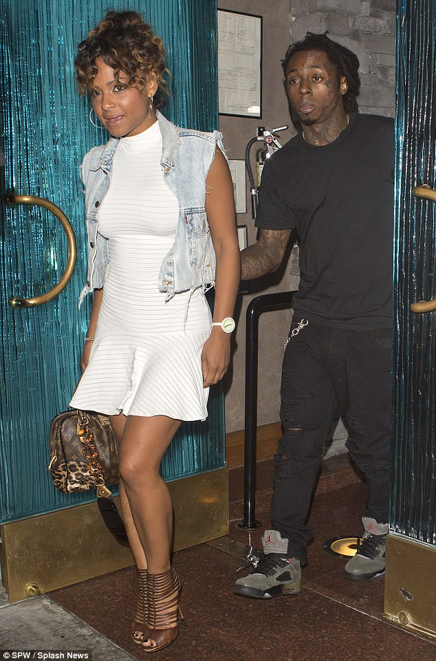 What a gentleman: Weezy made sure to hold the door open for the songstress