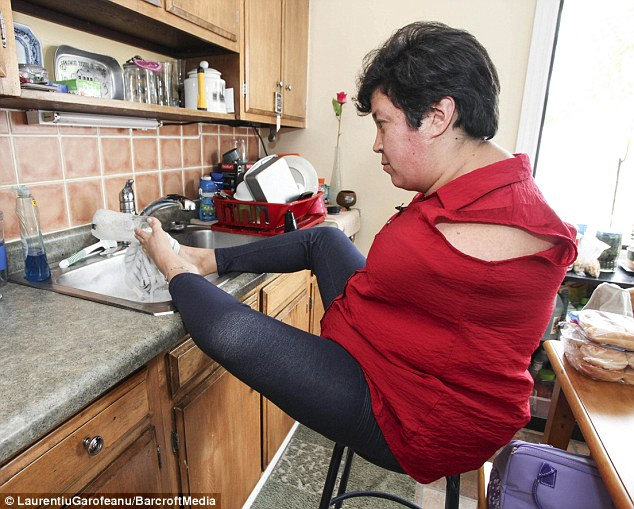 Mrs Bannon, 35, refuses to let her disability get in the way of her living a normal life, using her feet in place of her hands