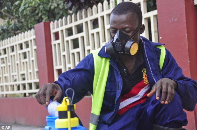 A government worker in Liberia mixes disinfectant to spray the streets of Monrovia to try and bring the Ebola virus under control