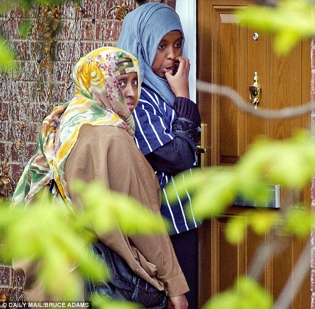 Family ordeal: Visitors are pictured arriving at the girls' home in Chorlton as the family try to persuade them to come home. Their father has flown out to Syria in a bid to find them but he has so far been unsuccessful