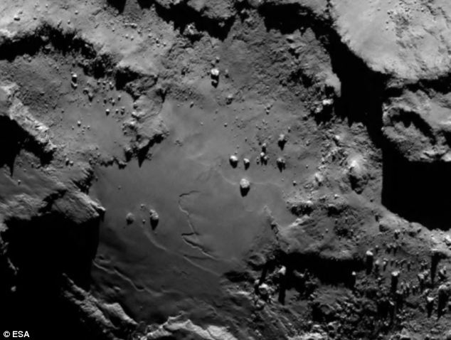 Close up detail focusing on a smooth region on the 'base' of the 'body' section of comet 67P/Churyumov-Gerasimenko. The image was taken by Rosetta's OSIRIS narrow-angle camera and downloaded today