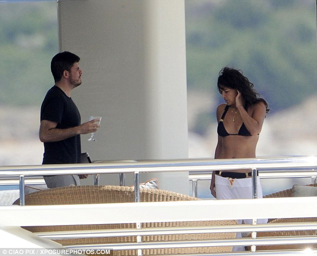 By the sea: Michelle Rodriguez spends time with pals on a mega-yacht in Sardinia, Italy, on Wednesday