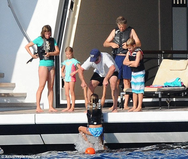 Family fun: Bill Gates, wife Melinda, daughter, Phoebe, son Rory and daughter Jennifer (being pulled from water) prepare to get wet off the coast of Porto Cervo