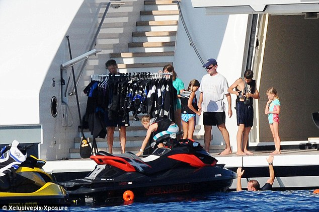 Adventure: The Gates family get ready to jet ski aboard the $5million-a-week superyacht The Serene which the billionaire is renting from the owner of the Stolichnaya vodka brand