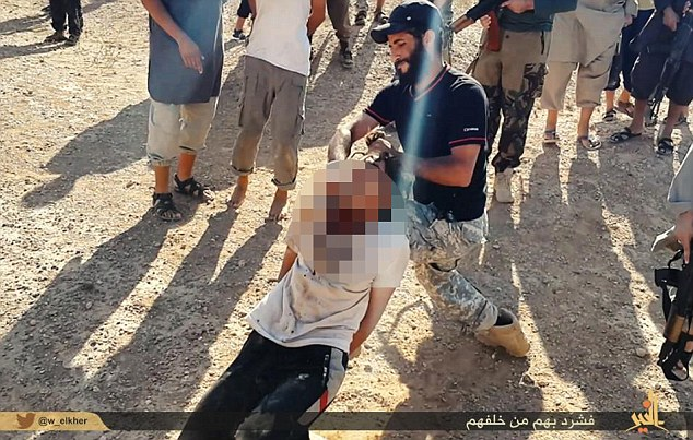 Sick: A jihadist appears to be smiling as he holds a terrified man by his hair and begins to slice through his neck with a hunting knife