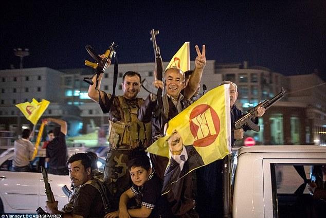 Battle ready: Peshmerga Kurds show of their readiness to fight ISIS on streets of Kurdish capital Erbil
