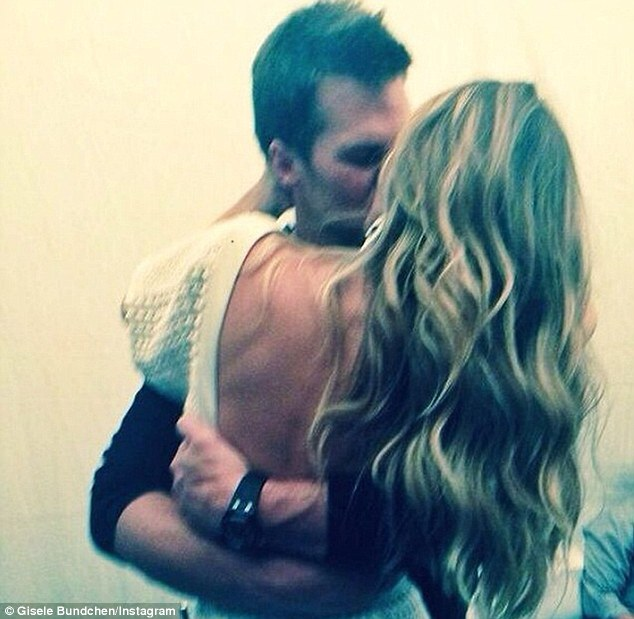 'Missing you so much!' Gisele shared this photo of her husband Tom Brady planting a kiss on her