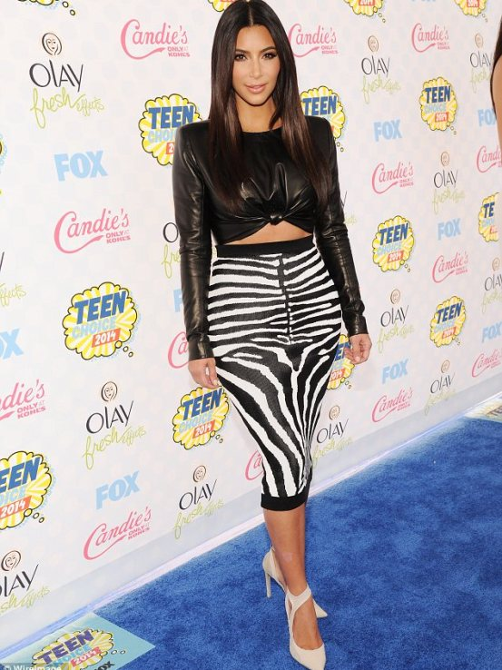 Wild thing: Kim was going for an edgy look with her leather top and zebra print pencil skirt, along with white heels
