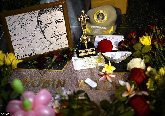 You will be missed: Flowers are placed in memory of Robin Williams, the Academy Award winner and comic supernova whose explosions of pop culture riffs and impressions dazzled audiences for decades and made him a gleamy-eyed laureate for the Information Age