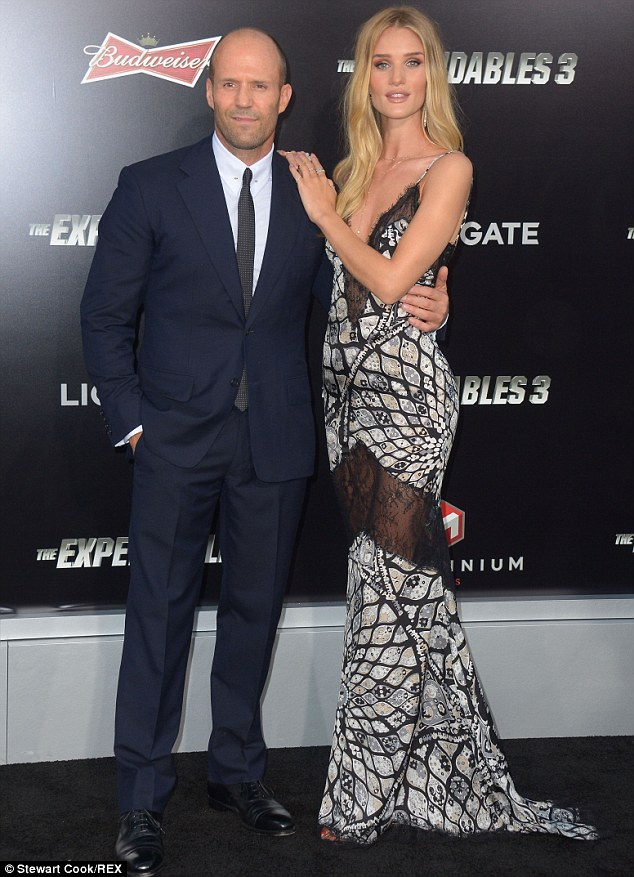 Arm candy: Jason Statham escorted girlfriend Rosie Huntington-Whiteley on Monday to the premiere of The Expendables 3 in Los Angeles