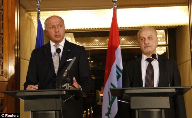 Fabius (L), like Obama and Secretary of State John Kerry, are urging Iraqi leaders to form an inclusive government that could reduce sectarian tensions -- but he's doing it alongside Iraqi Deputy PM Hussain al-Shahristani, not from a beach villa