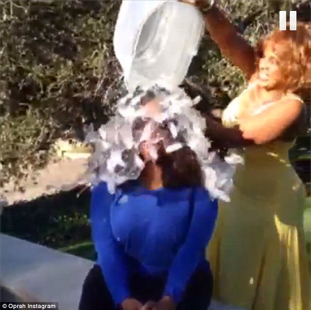 Surprise! The mogul had the bucket dumped on her head from behind