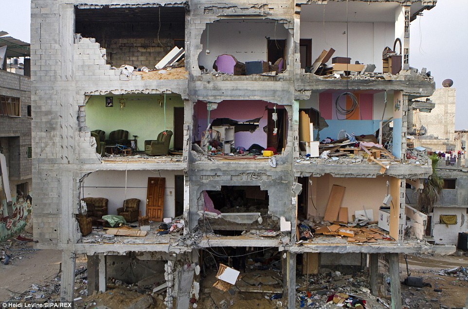 Rooms are seen in a damaged home early morning in the Shejaia neighborhood of Gaza City. There has been a temporary ceasefire between Israel and Hamas in Gaza