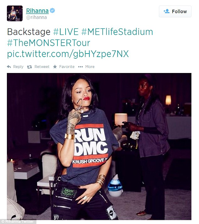 Punk zipper trousers: Later that night, Rihanna - born Robyn Fenty - shared a backstage snap at New Jersey's MetLife Stadium while holding a Run-D.M.C. T-shirt