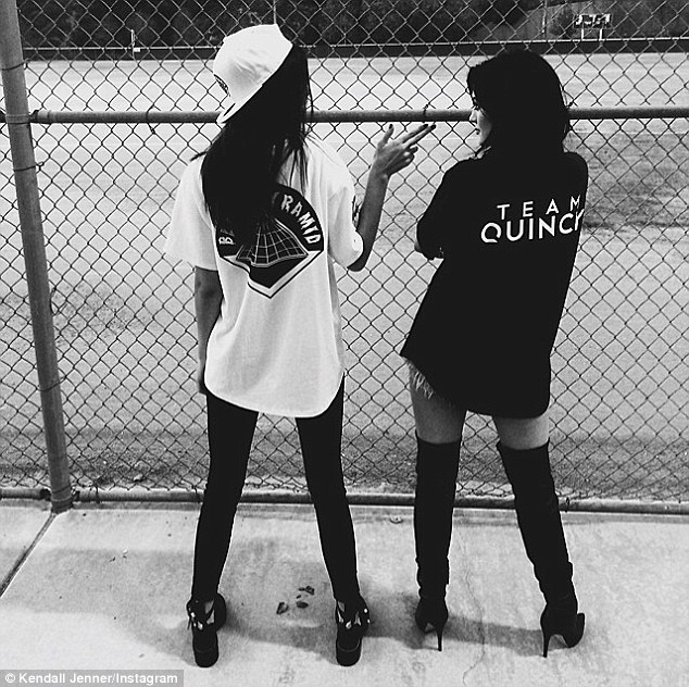 Sister opposition: At a charity kickball match in July, Kendall played on Chris' team as sister Kylie, 17, played on Quincy's team