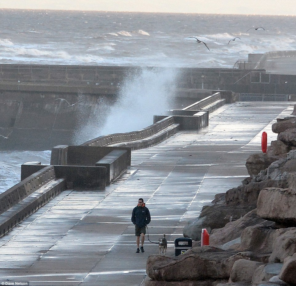 Stormy seas battering Blackpool Promenade this morning. Forecasters are predicting scattered showers, cool temperatures and windy weather for the next two weeks