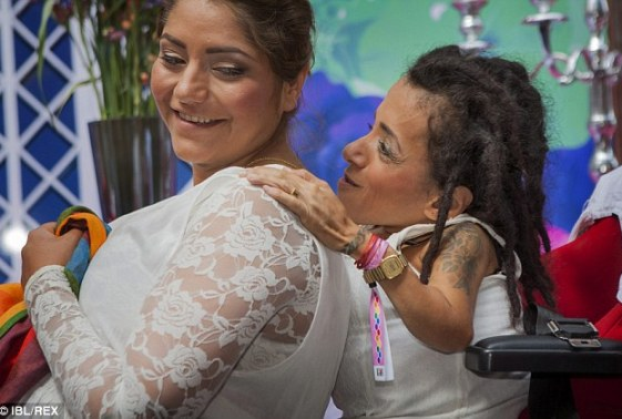 Delighted: Maryam Iranfar (left) and her new wife Sahar Mosleh (right) smile happily during their wedding