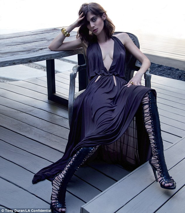 Razor sharp cheekbones: Masters of Sex star Lizzy Caplan got a sultry, glam makeover in a plunging gown and gladiator boots - both by Emilio Pucci