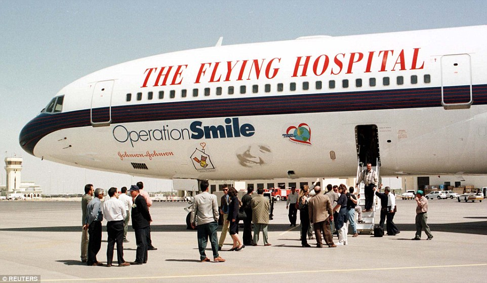 Palestinians stand next to the Flying Hospital, an aircraft carrying dozens of international surgeons at Gaza Airport in Gaza. The aircraft belonged to Operation Smile, an international humanitarian foundation established in 1982 to improve the lives of children worldwide