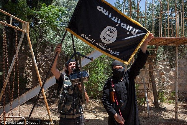 Terror: Islamic State militants have swept through Iraq and Syria, flying their flag near Aleppo (pictured)