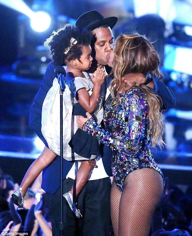 Loved-up: An emotional Beyonce hugged and kissed Jay Z and Blue after the superstar rapper handed over the prestigious Vanguard Award