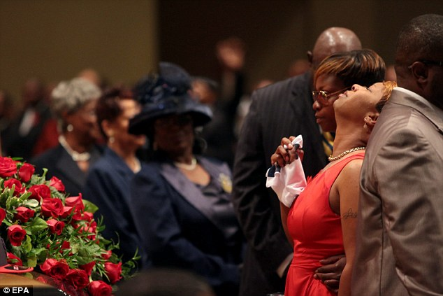 Overcome: Lesley McSpadden appears overwhelmed with grief during the service
