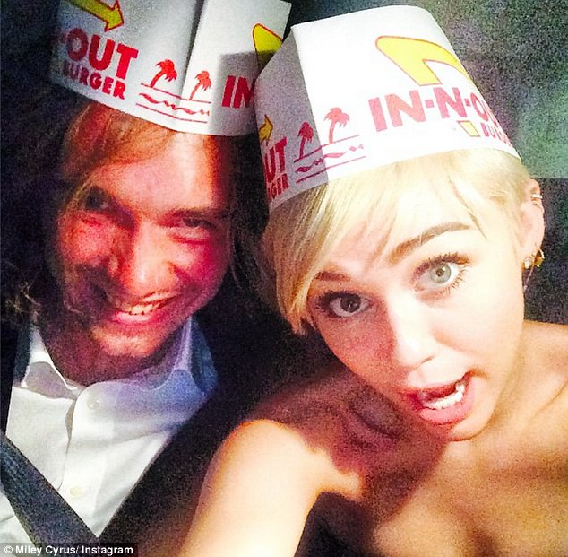Hot date: Miley Cyrus had her homeless friend Jesse accept her award so he could give a speech on his plight and she later treated him to In N Out burgers