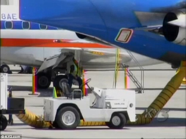 A mechanic inspects the plane after it made an emergency landing in Springfield, Missouri