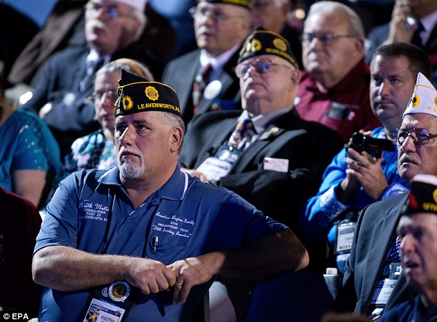Not impressed: American Legionnaires only rose to their feet to praise fellow veterans and hoot about firing VA miscreants, whiel they sat on their hands for Obama's applause lines about his military strategy