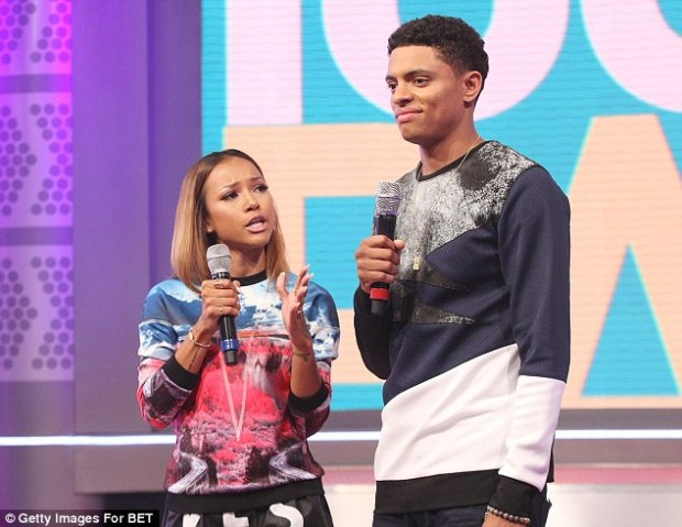 Rookie mistake: Chris Brown's 26-year-old girlfriend and co-host Brandon Broady's gag went down like a lead balloon, with the model giggling awkwardly before apologising, 'Sorry Blue, I love you!'