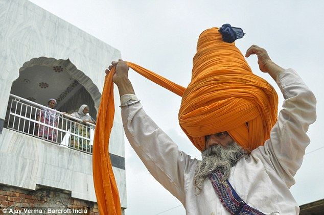It's a wrap: Most other Sikhs wear turbans that measure between five and seven metres