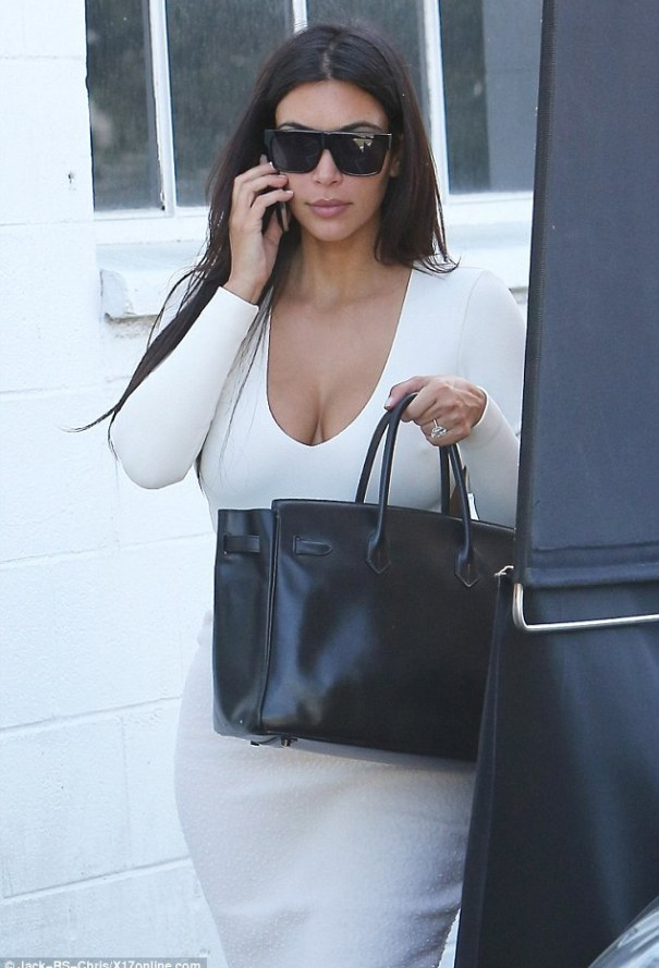 Heaven-sent! Kim Kardashian was angelic in white as she arrived at a studio in Hollywood on Wednesday