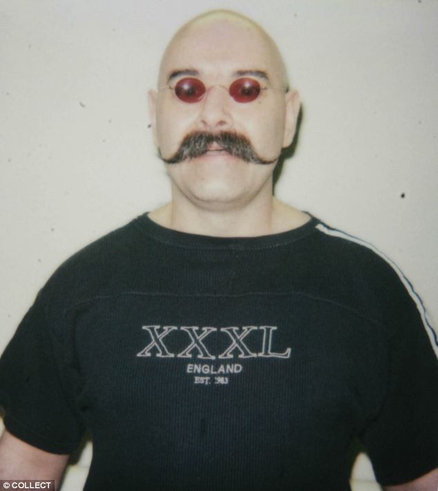 Bronson pictured in Wakefield Prison in June 2004 in a return to his trademark moustache and glasses