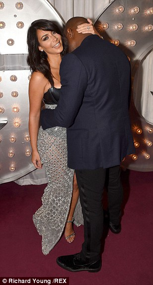 Getty frisky! The married couple couldn't keep their hands of each other as they joined a host of stylish celebrities at the mens' magazine event