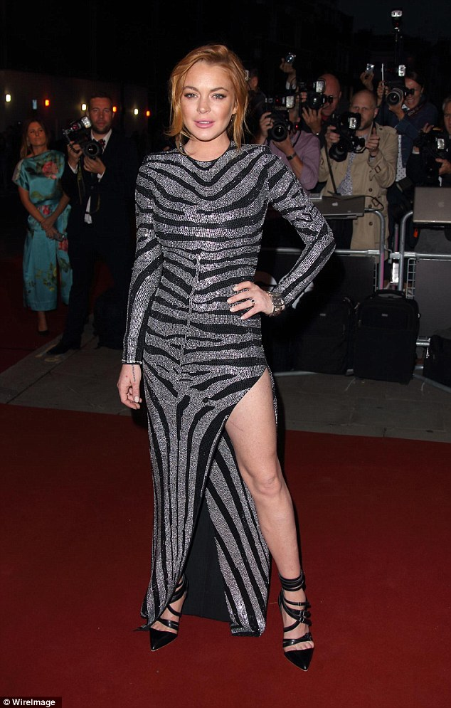 Wild: Lindsay Lohan put her wild character on show when she dressed in a zebra print maxi with a high slit