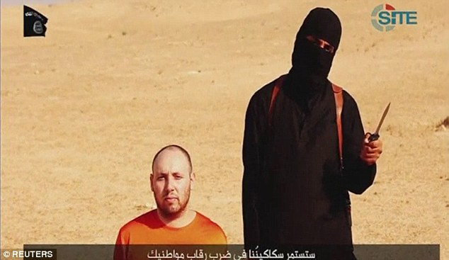 Retaliation: The fighter who apparently beheads Sotloff in the video calls it retribution for Obama's continued airstrikes against the group